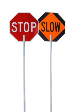 stop sign and slow sign on a staff for traffic flaggers