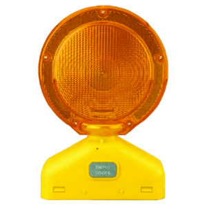 orange construction flashing light for baricades and drums