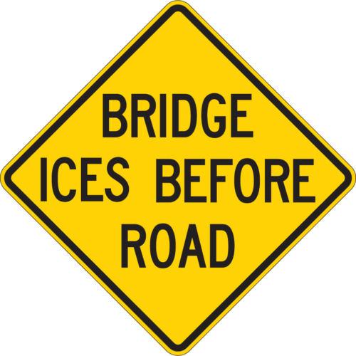 bridge ices before road diamond yellow sign