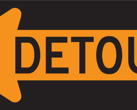detour left yellow and black sign