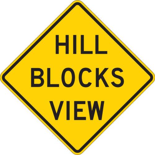 hill blocks view yellow diamond sign