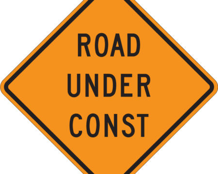 road under construction sign orange diamond
