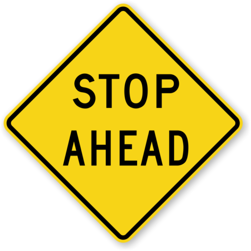 stop ahead yellow safety sign