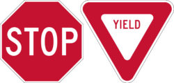 red and white stop yield signs