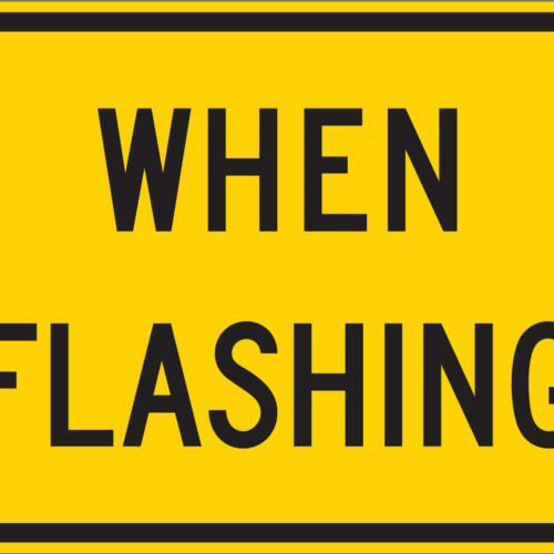 when flashing yellow and black sign