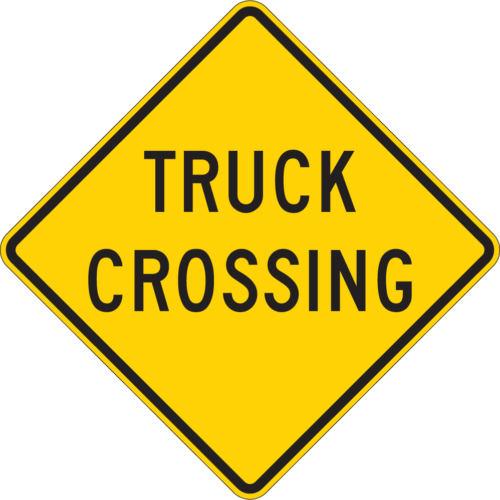 truck crossing diamond yellow sign