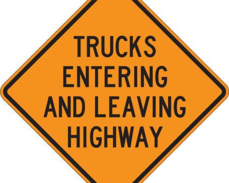 trucks entering and leaving highway orange sign diamond