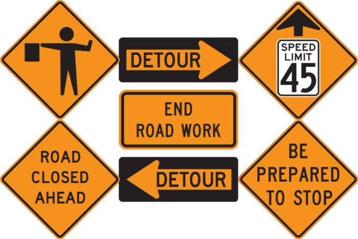 temporary traffic signs orange and yellow tint