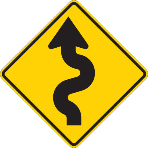 winding road yellow sign