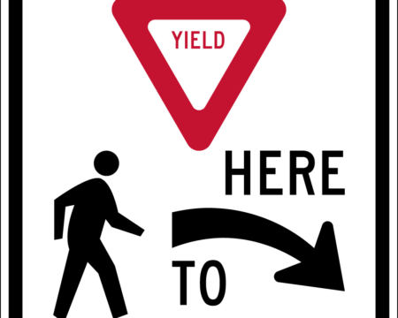 yield here to pedestrians right sign