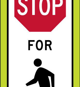 state law stop pedestrians crosswalk yellow panel sign