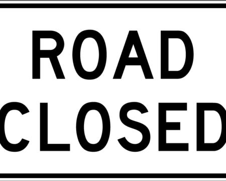 road closed white sign