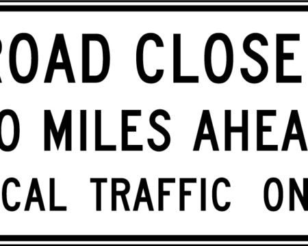 road closed miles ahead local traffic ahead white sign