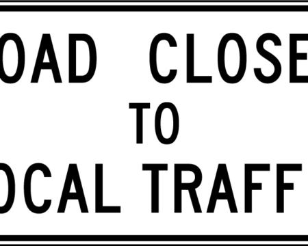 road closed to local traffic white sign