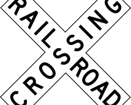 railroad crossing white sign