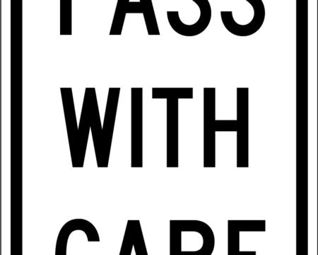 pass with care white sign