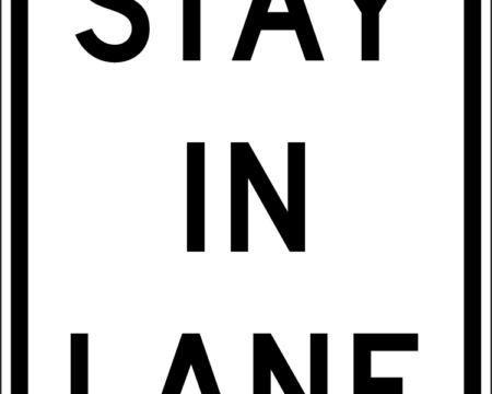 stay in lane white black sign