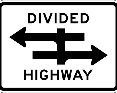 black divided highway with arrows sign