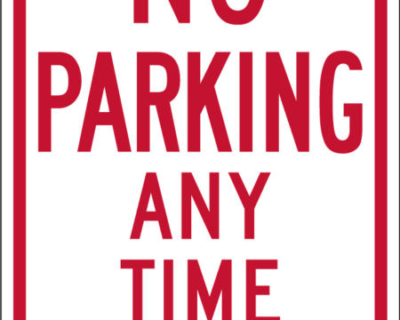 no parking any time left sign red