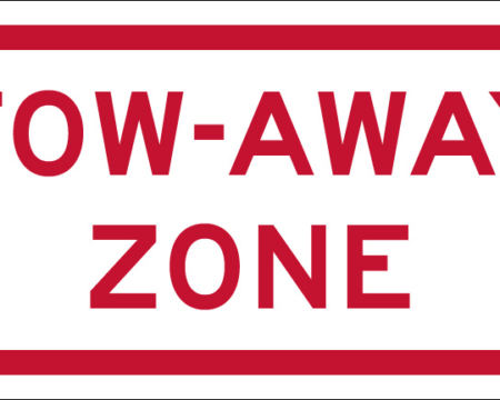 tow away zone red white sign