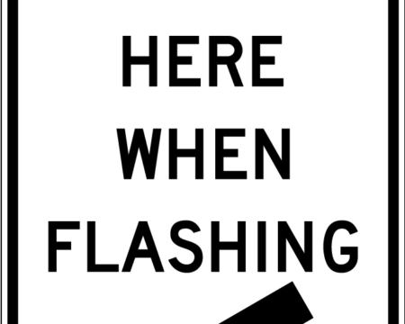 stop here when flashing white sign