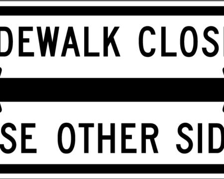 sidewalk closed use other side both side arrows white sign