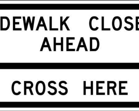 sidewalk closed ahead right arrow cross here sign