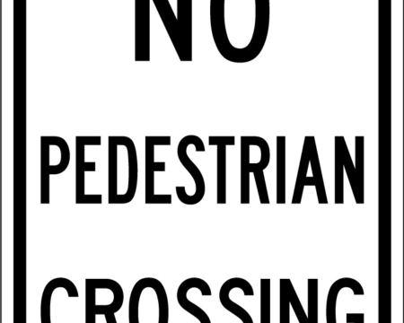 no pedestrian crossing white sign
