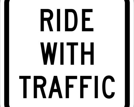 ride with traffic white sign