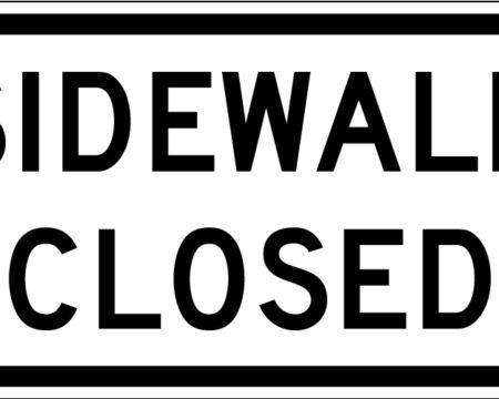 white sidewalk closed sign