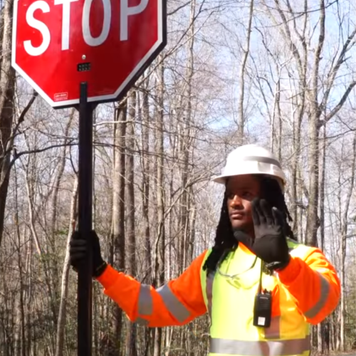flagger paddle, stop slow paddle, crossing guard, traffic signs, hald held stop sign, led stop sign, lighted stop sign.